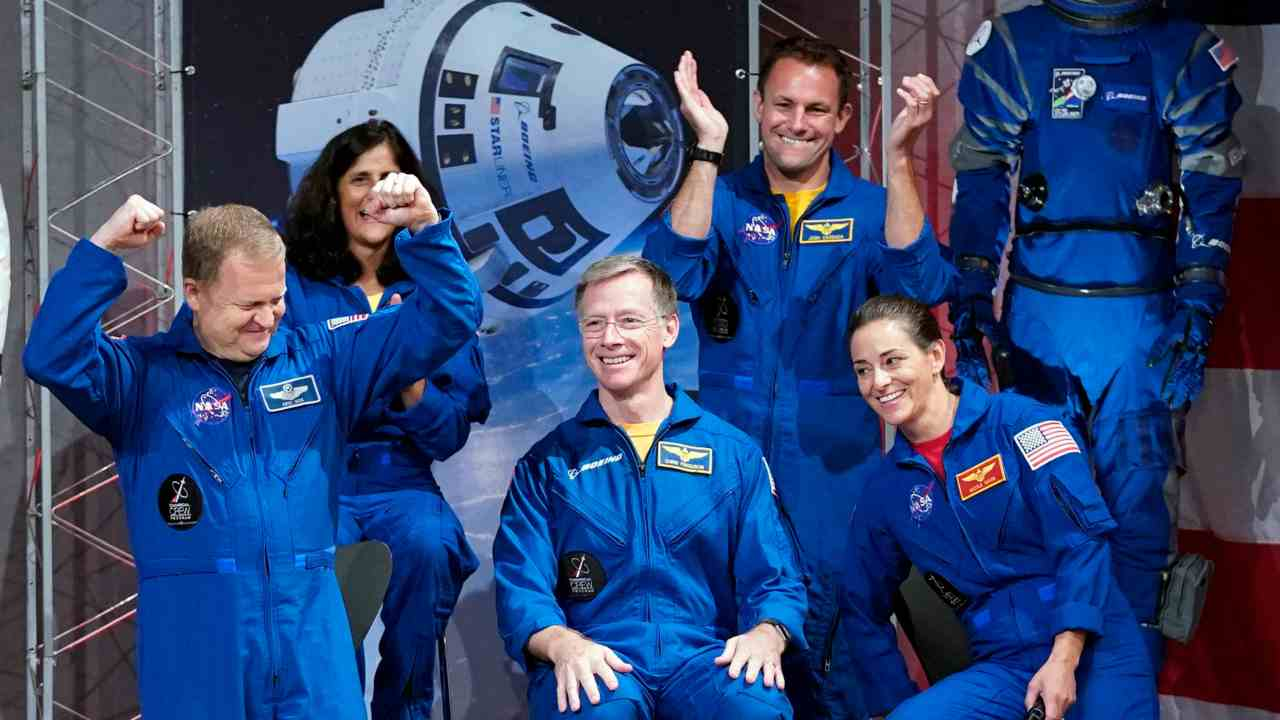 Astronauts, from left, Eric Boe, Sunita Williams, Christopher Ferguson, Josh Cassada and Nicole Mann react after being introduced at a NASA event to announce them as astronauts assigned to crew the first flight tests and missions of the Boeing CST-100 Starliner and SpaceX Crew Dragon in Houston. The astronauts will ride the first commercial capsules into orbit next year and return human launches to the US. (AP/ PTI)