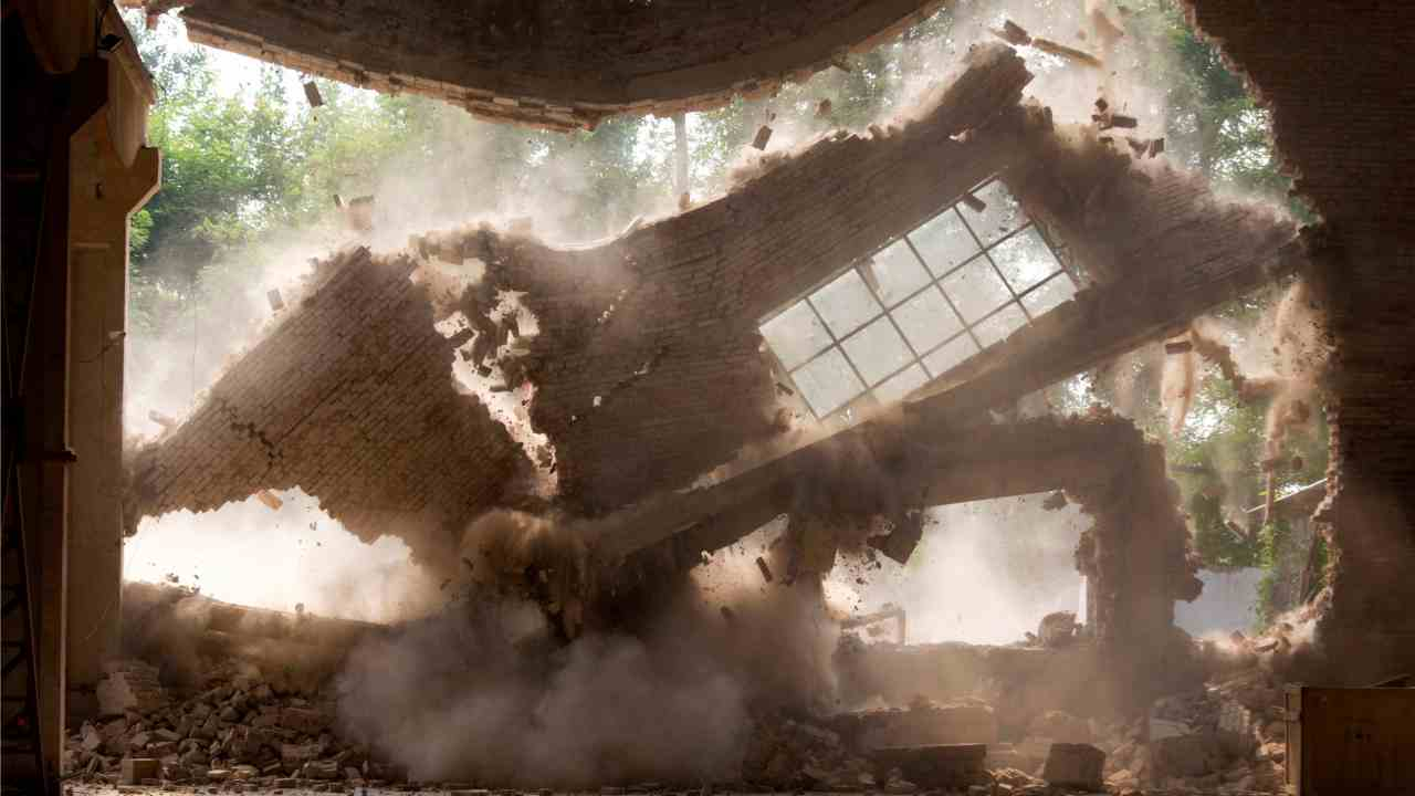 Walls of Chinese artist Ai Weiwei's studio collapse during demolition in Beijing.   (AP/PTI)