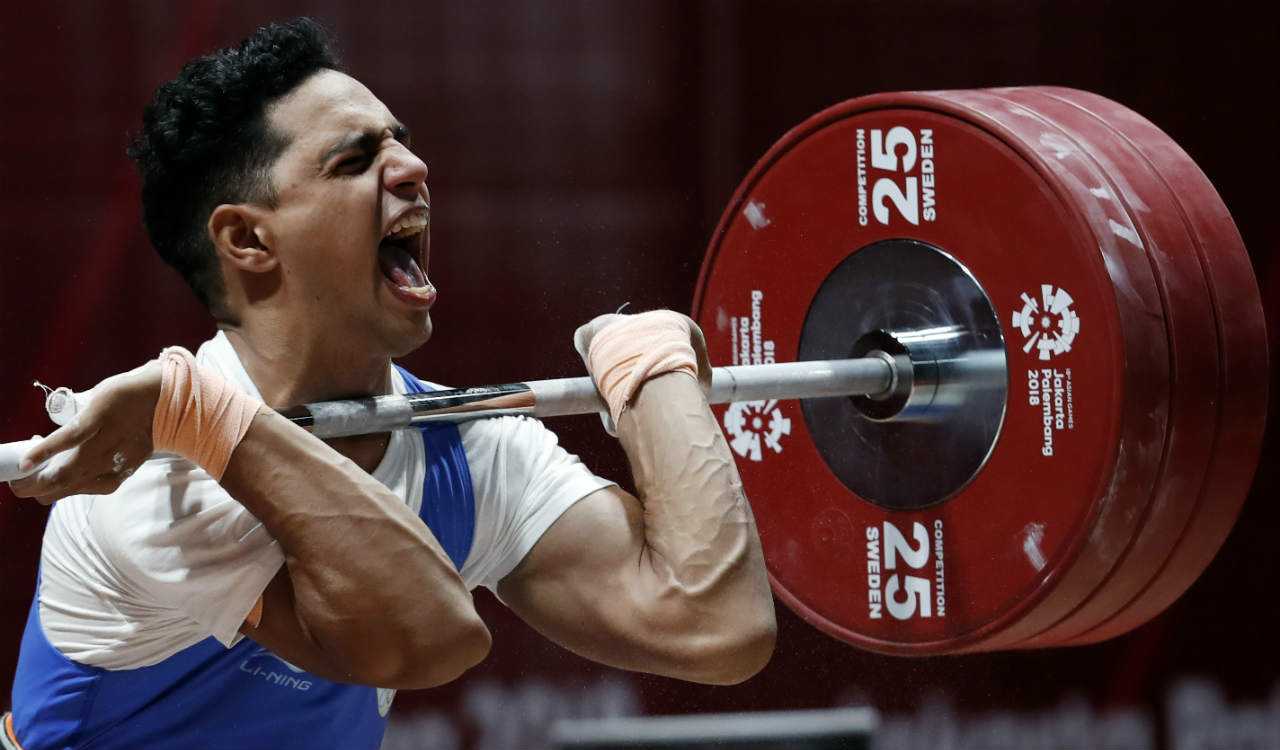Ajay Singh of India competes in Men's 77 kg category in weightlifting at 2018 Asian Games being held at Jakarta, Indonesia. (Reuters)