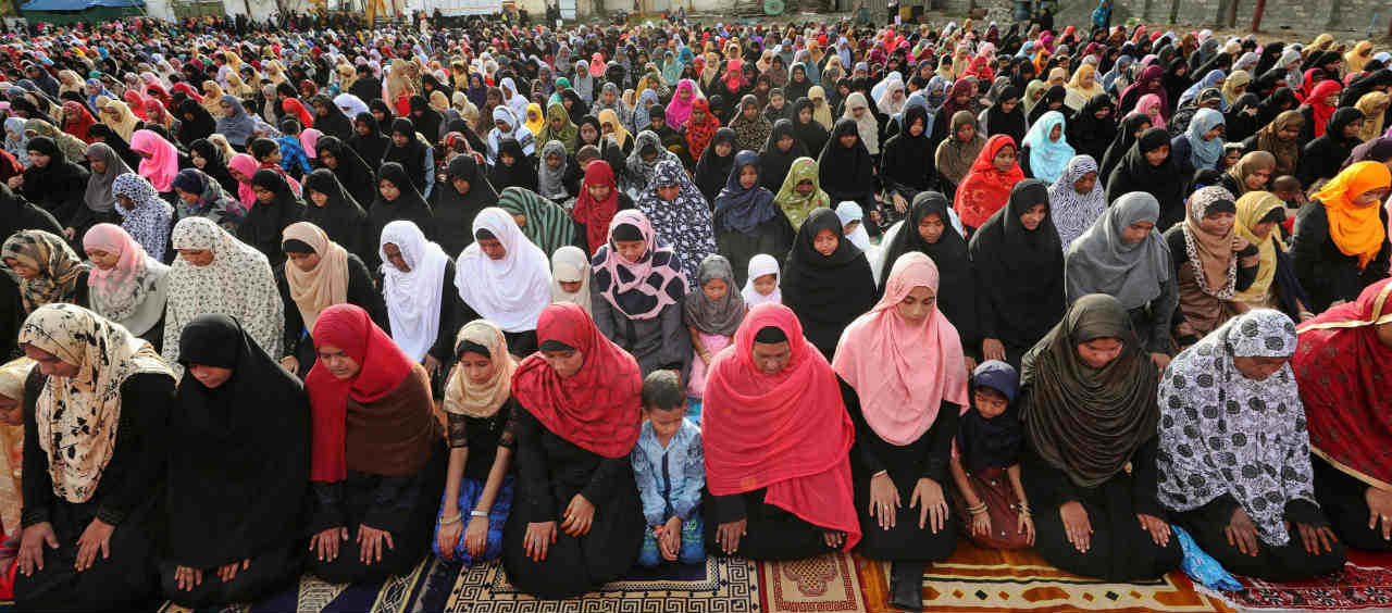 Jamiyyathul Ahlul Quran Wa Hadees (JAQH) group women members offer 'namaz' on the occassion of Eid-al-Adha festival at Ayisha Mahal ground in Coimbatore. (PTI)