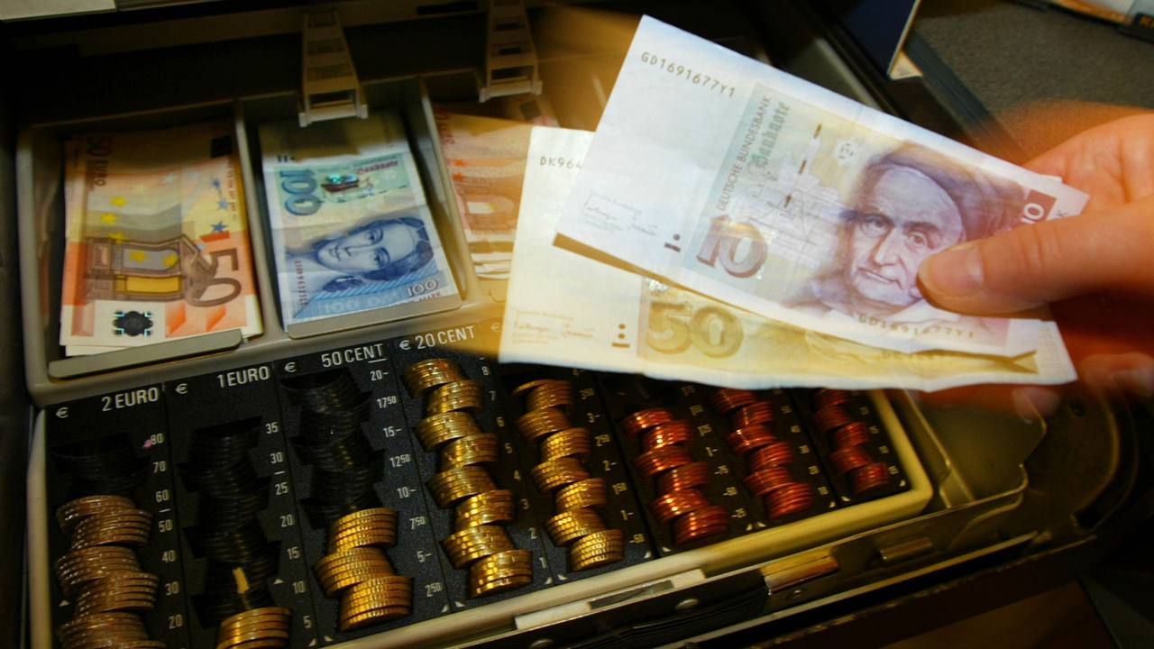 World War I crippled the German economy as it faced one of the worst cases of hyperinflation. The German government, to finance its military, printed marks with no backing. It eventually lost the war and was strapped with massive debt. Reparations were to be paid to allies under the treaty of Versailles. The exchange rate of the German mark to the dollar rose from 4.2 to one in 1914, to 4.2 trillion to one in 1923, raising panic and mistrust. The images of wheelbarrows full of currency used to pay labour wages and children stacking up wads of useless notes to make play houses first captured the public's imagination in this turbulent period of the German economy. (Image: Reuters)
