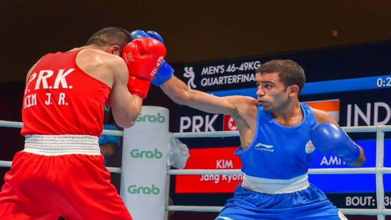India's Amit Panghal (Blue) and PR Korea's Ryong Jong compete in the Men's Light Fly (46-49kg) Quarterfinal boxing event in the 18th Asian Games 2018 in Jakarta, Indonesia on Wednesday. Image Source: PTI.