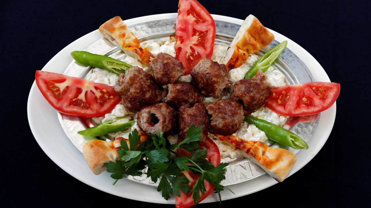 Europe   Least expensive city: Istanbul — Rs 1,417 for a three-course meal. - (Pictured) A portion of Alinazik kebab, minced lamb kebab over mixture of yogurt, eggplant and garlic puree. (Image: Reuters)