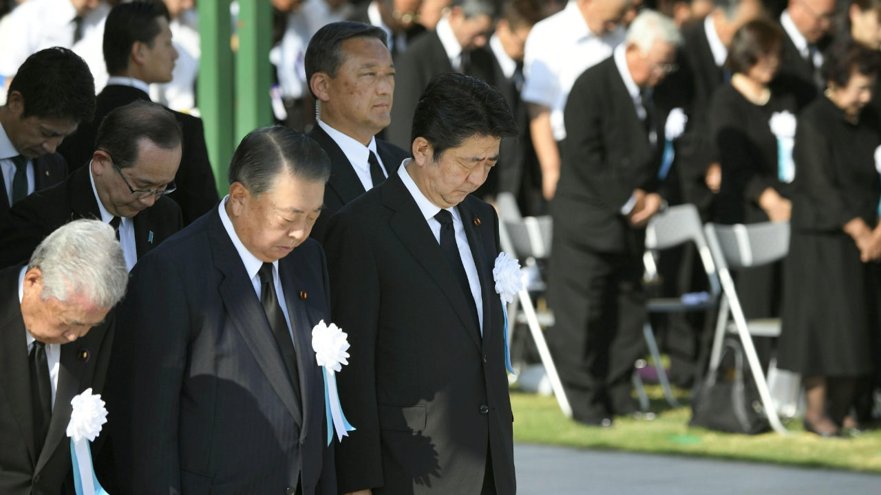 Japan's Prime Minister Shinzo Abe and other officials offer a silent prayers for the victims of the 1945 atomic bombing, at Peace Memorial Park in Hiroshima, western Japan on the 73rd anniversary of the atomic bombing of the city. (Photo: Kyodo/ via Reuters)