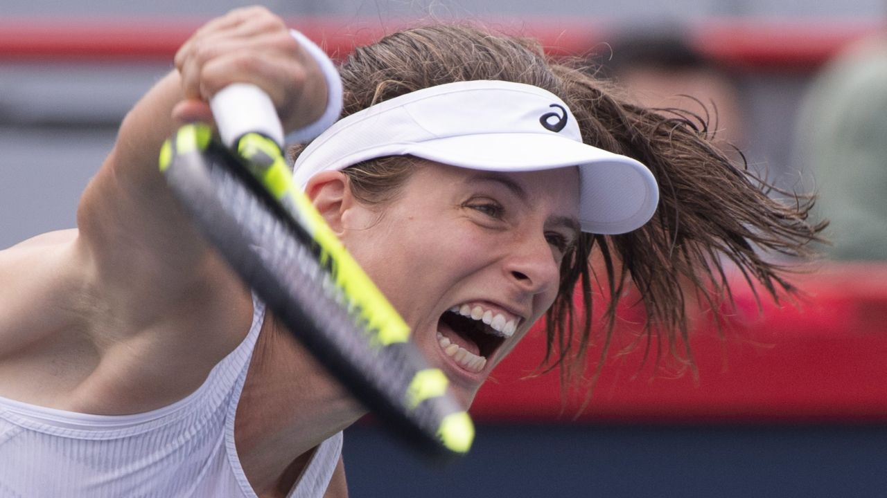 Johanna Konta, of Britain serves to Jelena Ostapenko, of Latvia, during the first round of the Rogers Cup women's tennis tournament, on August 7, 2018, in Montreal. (Image Source: PTI)