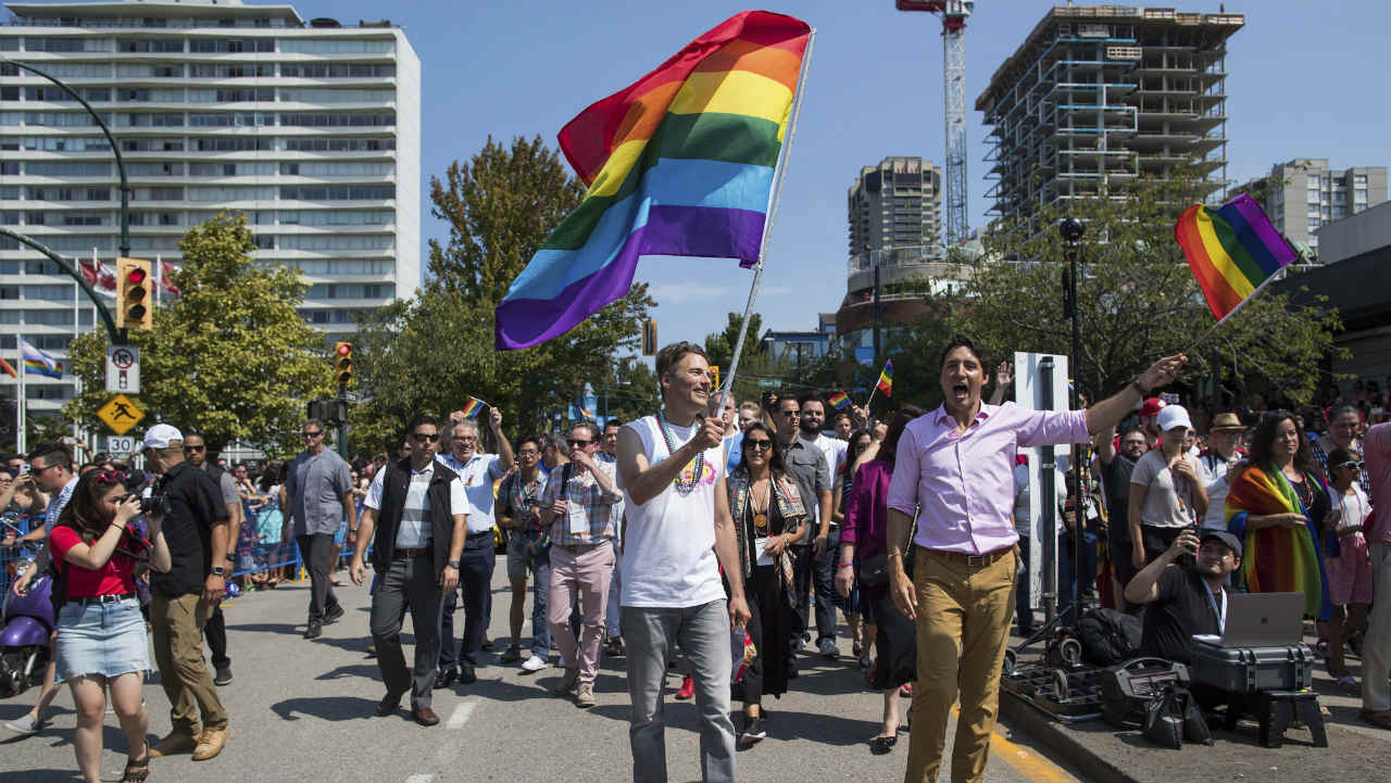 Prime Minister Justin Trudeau, right, and Vancouver mayor Gregor Robertson, center, march in the Pride Parade in Vancouver. (Photo: AP)