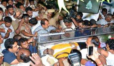 Why did the TN government deny land on Marina Beach for Karunanidhi's burial?