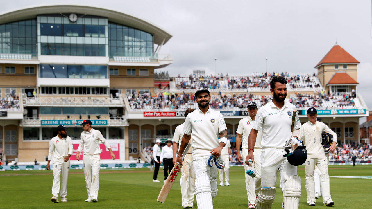 Virat Kohli and Cheteshwar Pujara continued batting for India on Day 3. They batted slowly throughout the session adding only 70 runs to the team's overnight total of 124. But the duo ensured that no wicket was lost in the first session. As the players walked off the filed for the Lunch on Day 3, India's total read 194/3 with commanding lead of 362 runs . (Image - Reuters)