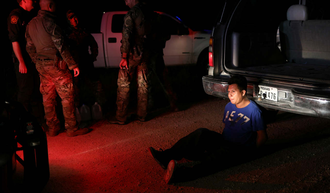 An undocumented man from Mexico is apprehended by Border Patrol agents after allegedly dropping off a group of migrants in an area known for human smuggling near Falfurrias, Texas, U.S. (Reuters)
