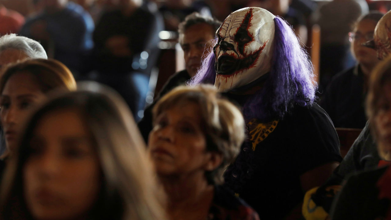 Mexican masked wrestler Monster Clown listens during a mass as part of the annual lucha libre pilgrimage to the Basilica of Our Lady Guadalupe in Mexico City, Mexico. (Reuters)
