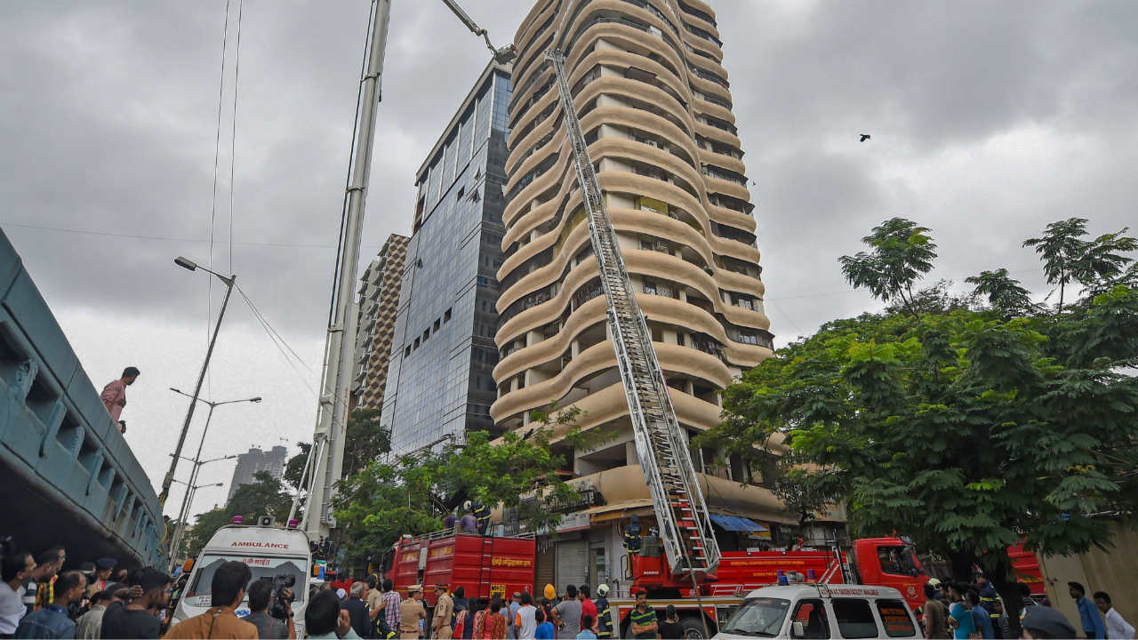 Fire fighters carry out rescue work after a fire broke out at the Crystal Tower at Parel in Mumbai. (Image: PTI)