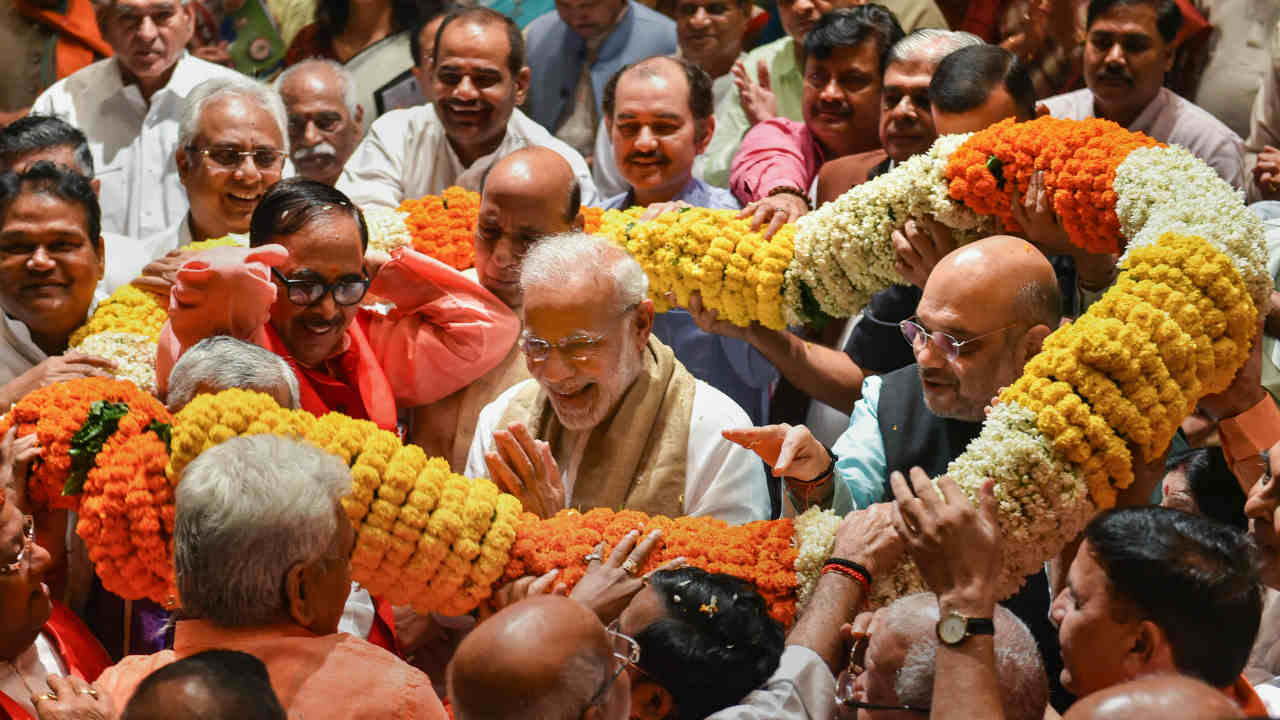 Prime Minister Narendra Modi is being greeted by BJP MP's during BJP Parliamentary Party meeting at Parliament House, in New Delhi on Tuesday. Rajya Sabha on August 06, 2018 cleared the Constitution (123rd Amendment) Bill, 2017 also referred to as the OBC bill during the ongoing Monsoon session. (PTI)