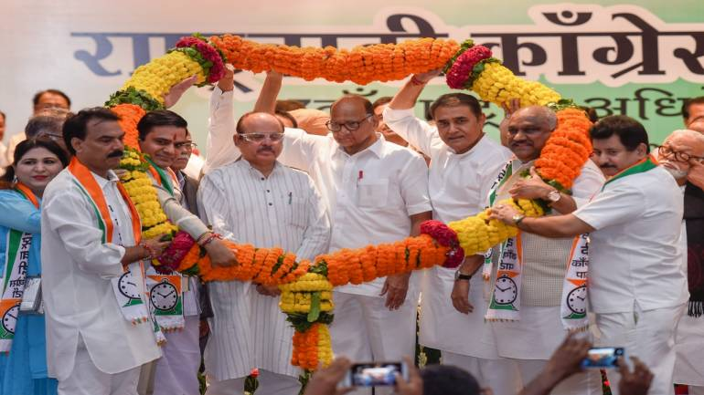 National Congress Party (NCP) President Sharad Pawar being garlanded during the Party's 7th National Convention, in New Delhi on Wednesday. Image Source: PTI.