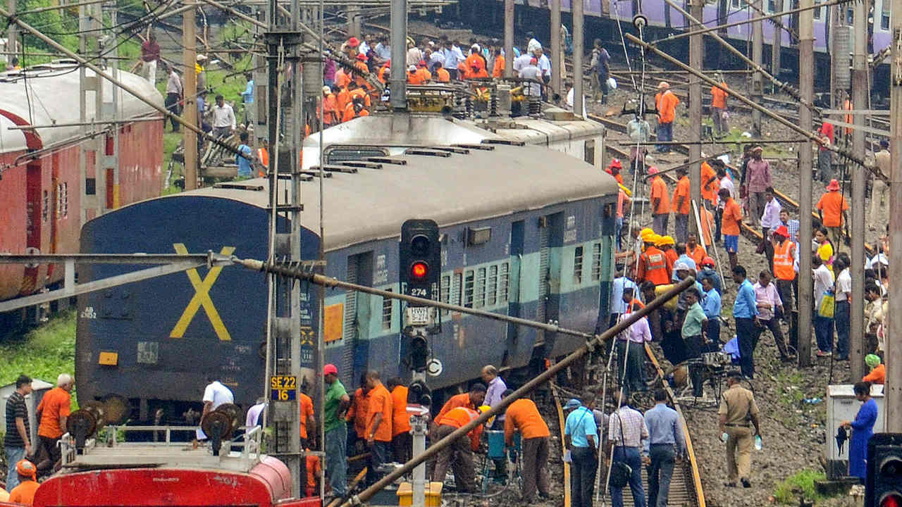 Railway engineers, technicians and workers carry out restoration works after the engine and a coach of an empty rake of Howrah-Titlagarh Ispat Express derailed while entering Howrah Station. (Photo: PTI)