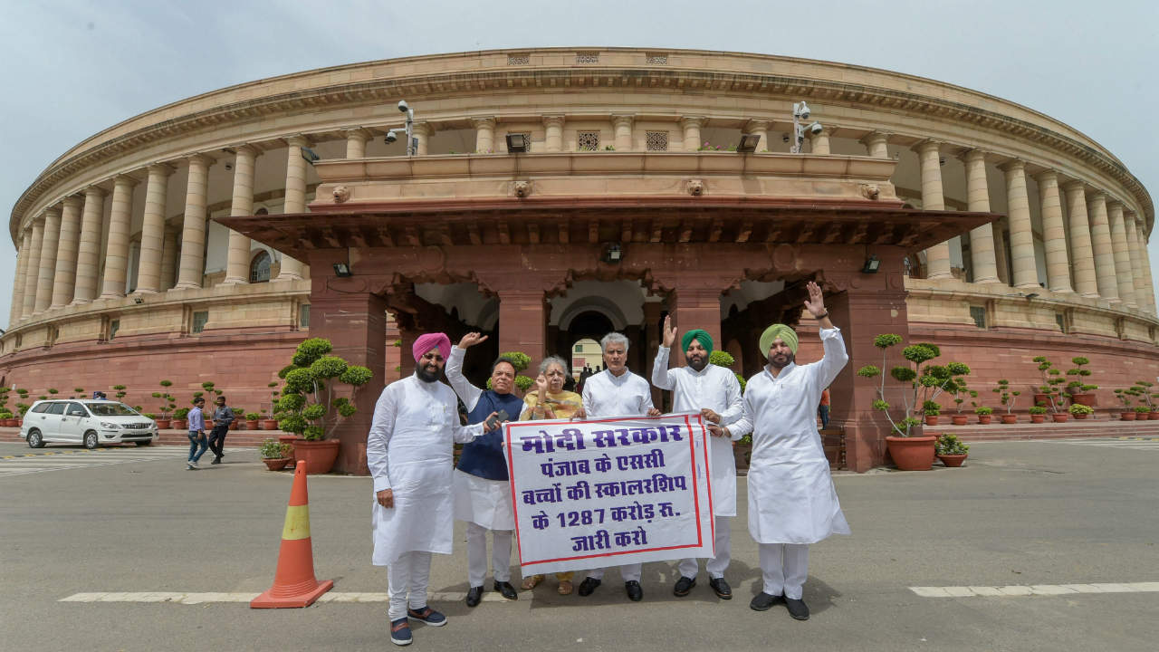 Congress MPs from Punjab stage a protest demanding for the release of the scholarships Schedule Caste children, during the Monsoon session of Parliament, in New Delhi. (Photo: PTI)