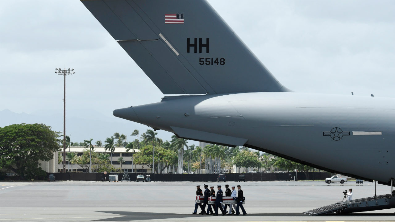 Honor guards carry caskets containing the remains of American servicemen from the Korean War handed over by North Korea upon arrival at Joint Base Pearl Harbor-Hickam in Honolulu, Hawaii, US. (Photo: Reuters)