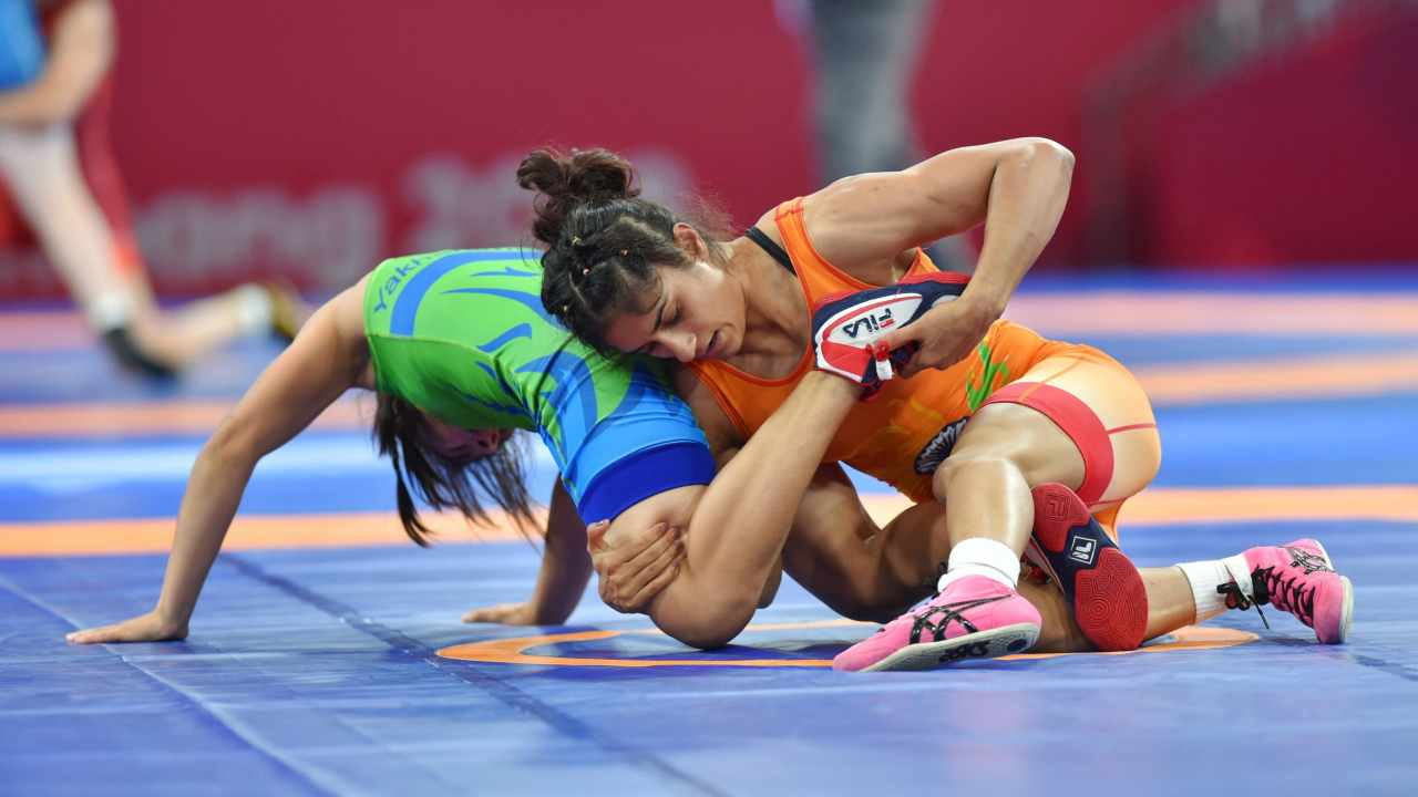 Vinesh Phogat of India (in orange) grapples with Uzbekistan's D Yakhshimuratova in the semifinals of women's 50kg freestyle wrestling event, at Asian Games 2018, in Jakarta. Phogat dominated on the mat and stormed into the final.(PTI)