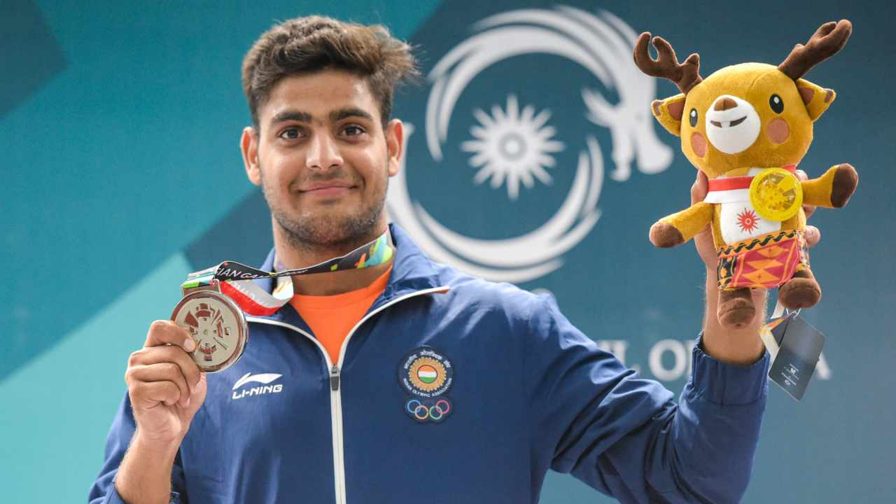 Silver medallist India's Lakshay Sheoran poses for photographs at the award ceremony of men's trap shooting event, during the 18th Asian Games 2018 at Palembang in Indonesia.(PTI)