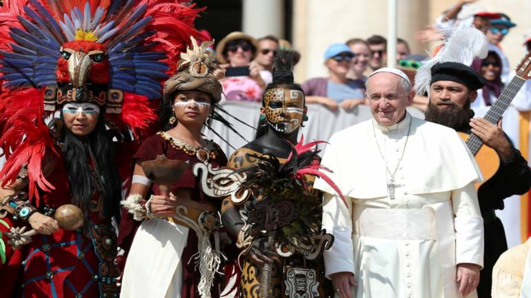 Pope Francis poses with participants of the Mexico state of Quintana Roo during the general audience in Saint Peter's square at the Vatican. Image Source: Reuters.