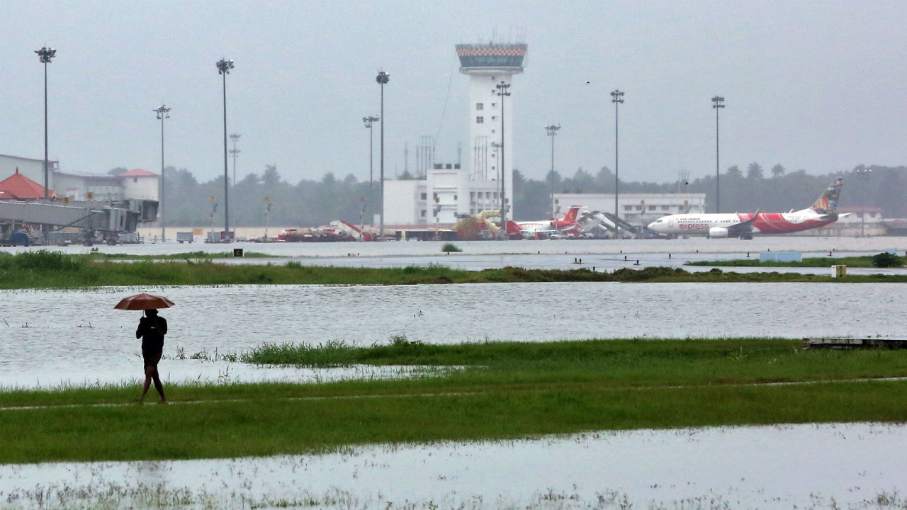 Waterlogging has resulted in suspension of operations at Kochi International Airport. The airport is the seventh busiest airport in the country. Commercial flight operations have commenced from a naval airport in Kochi. The naval airport is expected to be used until operations at Kochi's commercial airport can resume. Pictured: A man walks inside the flooded Cochin international airport. (Image: Reuters)