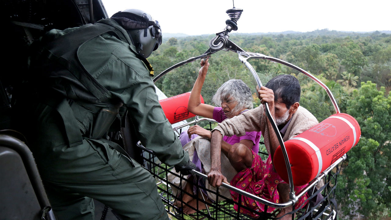 People are airlifted by Indian Navy personnel during a rescue operation at a flooded area in the southern state. (Image: Reuters)