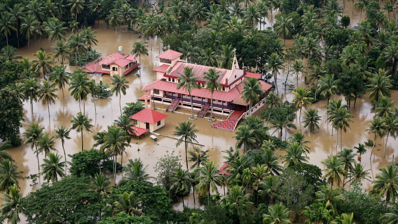 370 people have died and around 20,000 houses damaged in floods in Kerala that have wrecked havoc in the state since August 8. Pictured: An aerial view shows partially submerged houses and church in a flooded area in Kerala. (Image: Reuters)