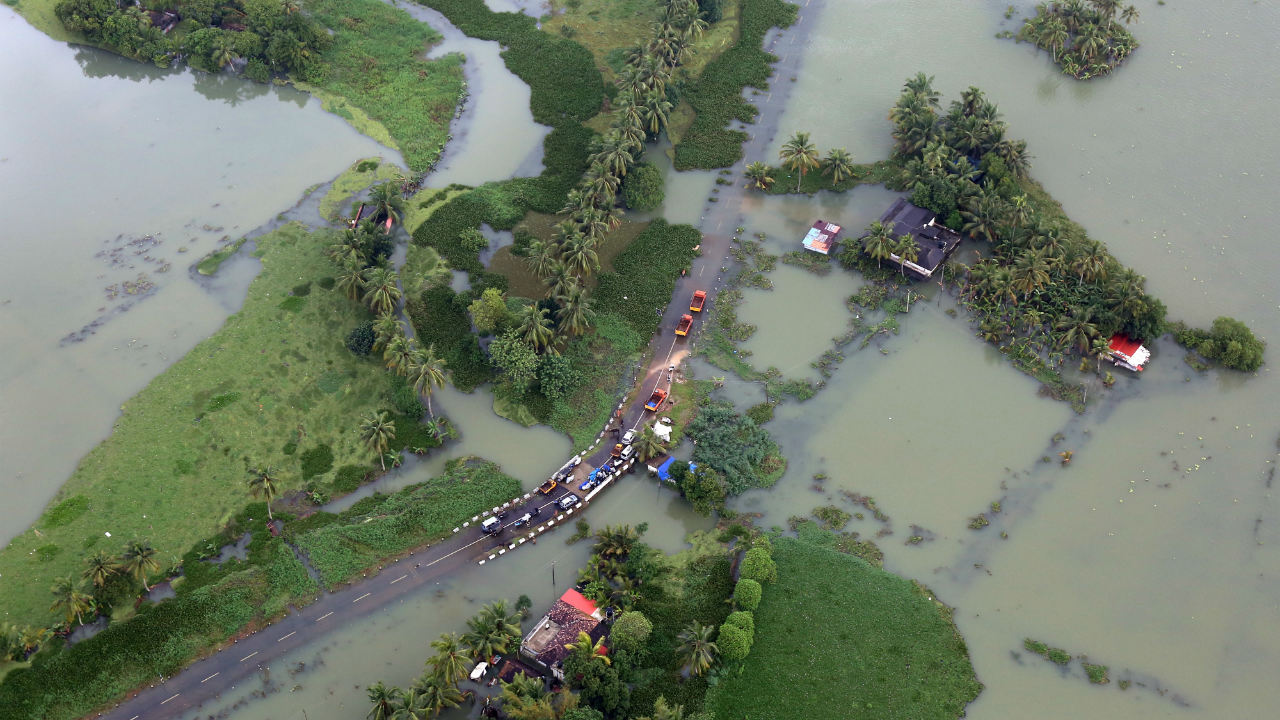According to a Financial Times report, the damage caused by the floods is around Rs 18,840 crore. During early days of flooding, Kerala Chief Minister Pinarayi Vijayan had said that overall loss caused by the floods was Rs 8,316 crore. Pictured: An aerial view of partially submerged roads in the state. (Image: Reuters)