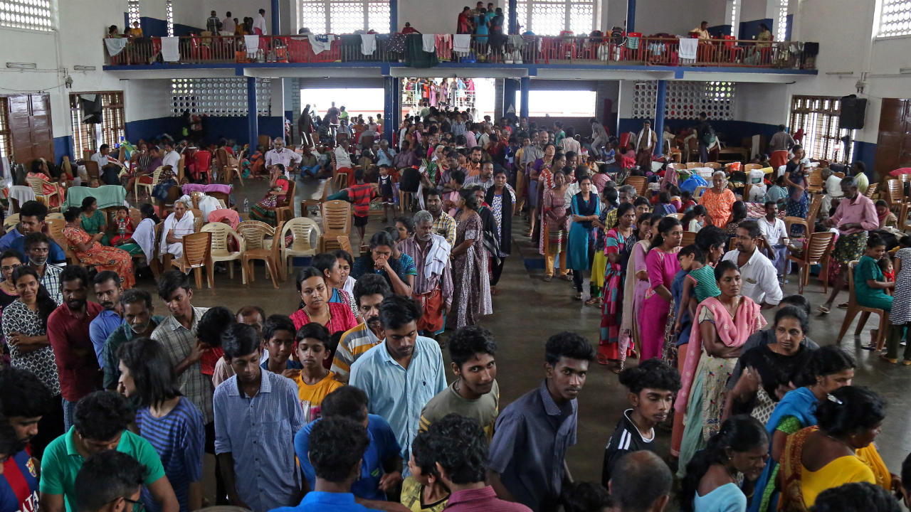 CM Vijayan has said that Kerala has enough food to feed the affected people. However, transportation of food material has proved to be a bigger challenge as multiple key highways remain submerged. Pictured: Flood victims wait for food inside a college auditorium, which has been converted into a temporary relief camp, in Kochi. (Image: Reuters)