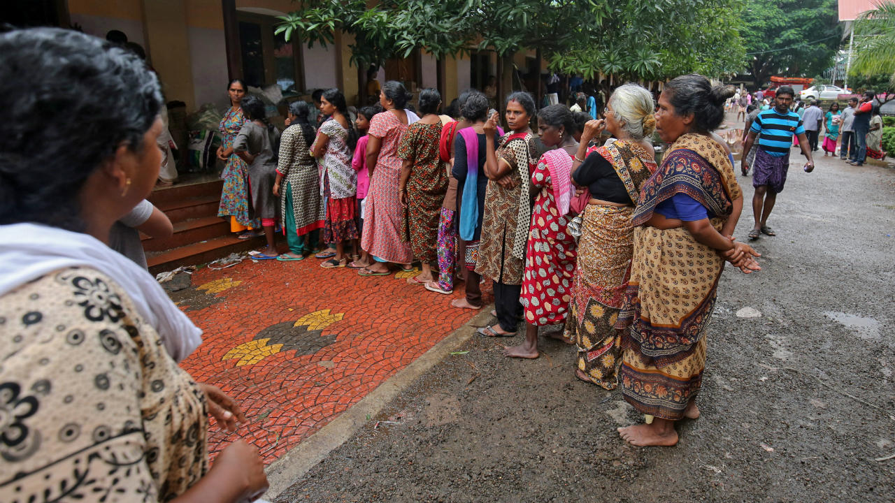 The situation in Kerala is expected to take months to normalise and years before parts of the state are reconstructed. Pictured: Flood-affected women wait in a queue to receive relief material at a camp in Chengannur. (Image: Reuters)