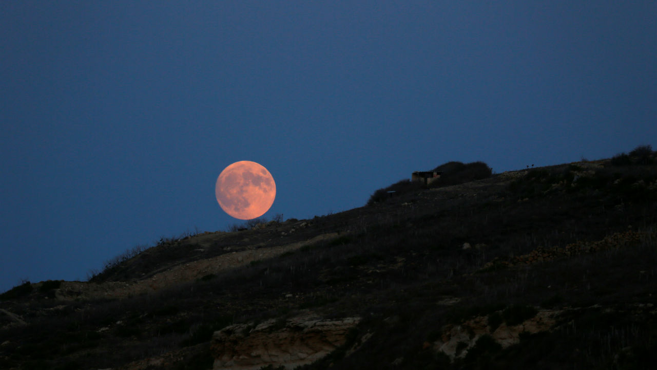 The rising full moon is seen from the Xwejni Salt Pans outside Zebbug, on the island of Gozo, Malta. (Image: Reuters)