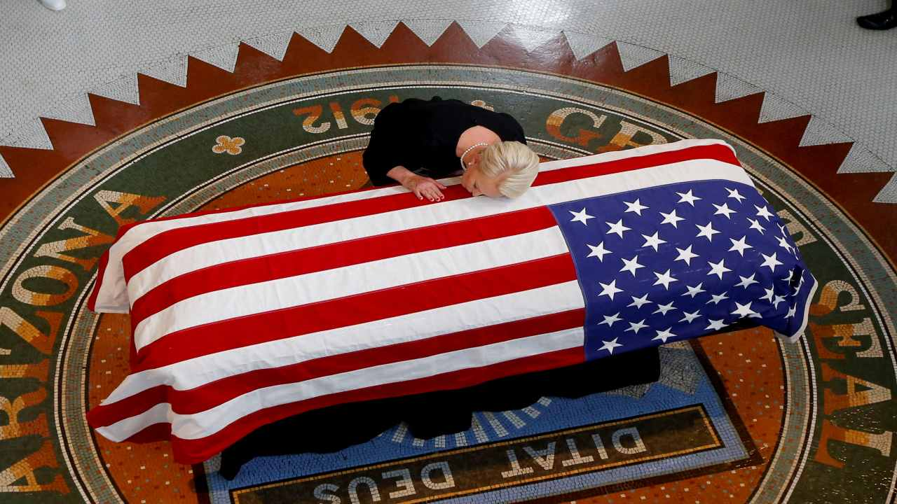 Cindy McCain, wife of U.S. Senator John McCain, touches the casket during a memorial service at the Arizona Capitol in Phoenix, Arizona, U.S. (Image: Reuters)