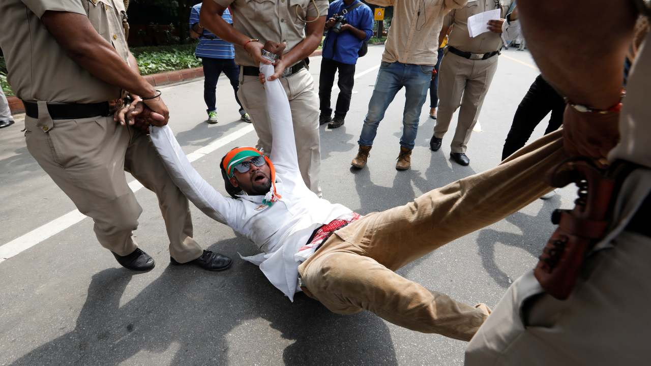 Police officers detain an activist of the youth wing of India's main opposition Congress Party during a protest, demanding that the government discloses the details of Rafale fighter planes deal, in New Delhi, India. (Image: Reuters)
