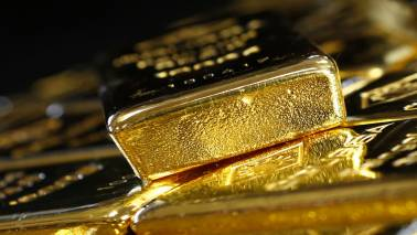 Gold falls as dollar firms after China halts trade talks