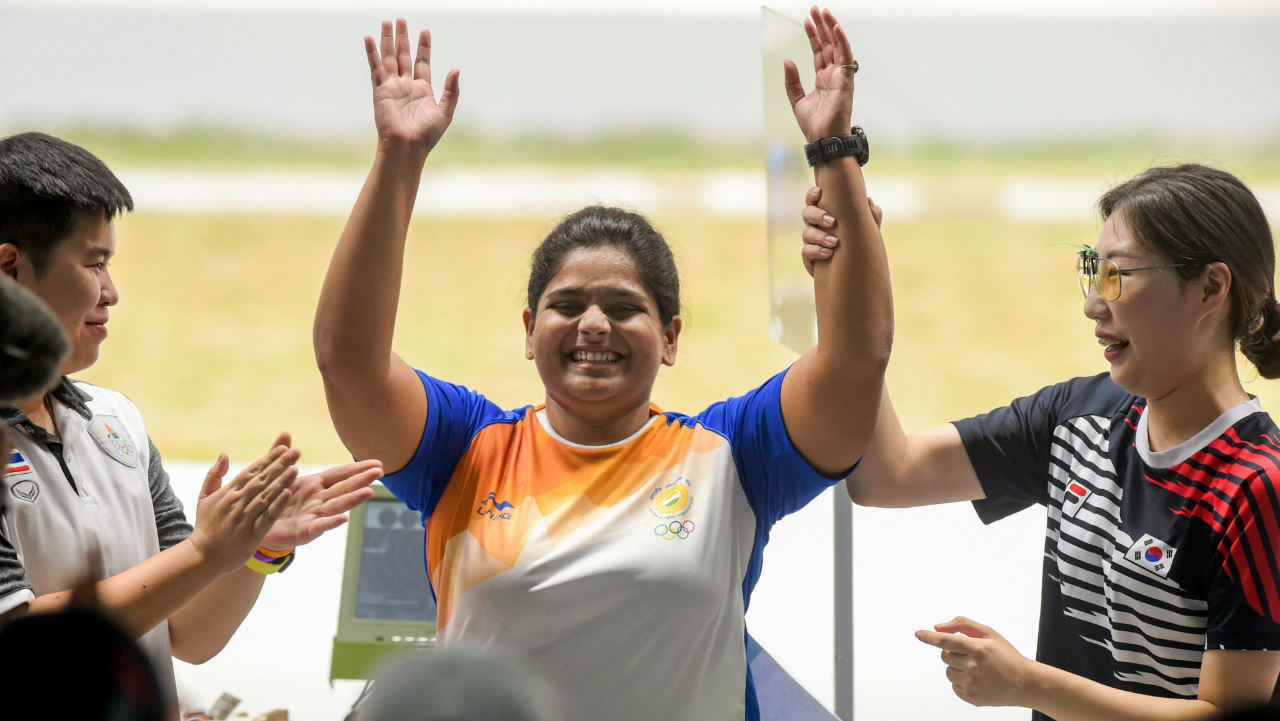 Gold medallist India's Rahi Sarnobat with Silver medallist Thailand's N Yangpaiboon (L) and Bronze medal winner Korea's Kim Minjung after the women's 25m pistol event during the 18th Asian Games at Palembang, in Indonesia. (Photo: PTI)