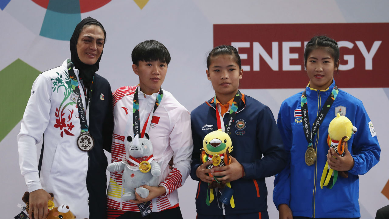 Roshibina Devi Naorem (second from left) | Wushu Women's Sanda 60kg | Bronze (Image : Reuters)