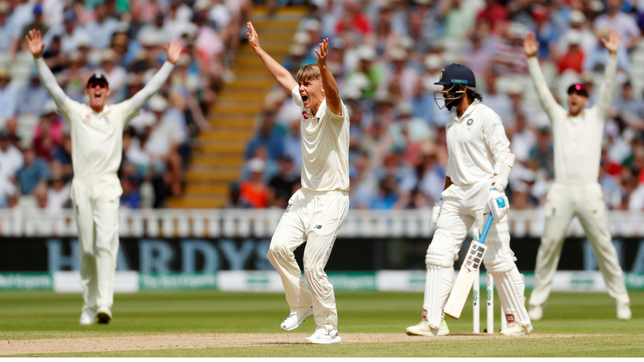 Sam Curran then sprang into life picking up three quick wickets to hurt India. He first trapped Vijay LBW and then also accounted for Rahul in the very same over as the batsman reached out for a shot outside off, only to end up sending the ball back onto his stumps. Dhawan also fell to the left-arm pacer, getting an edge which carried to the second slip. India were reduced to 59/3 from 50/0. (Image: Reuters)