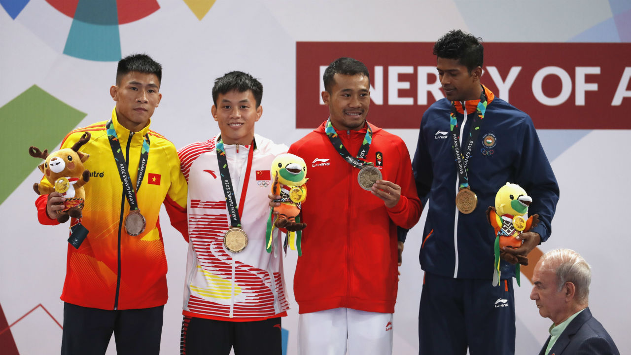 Santosh Kumar (extreme right) |Wushu Men's Sanda 56kg | Bronze (Image : Reuters)