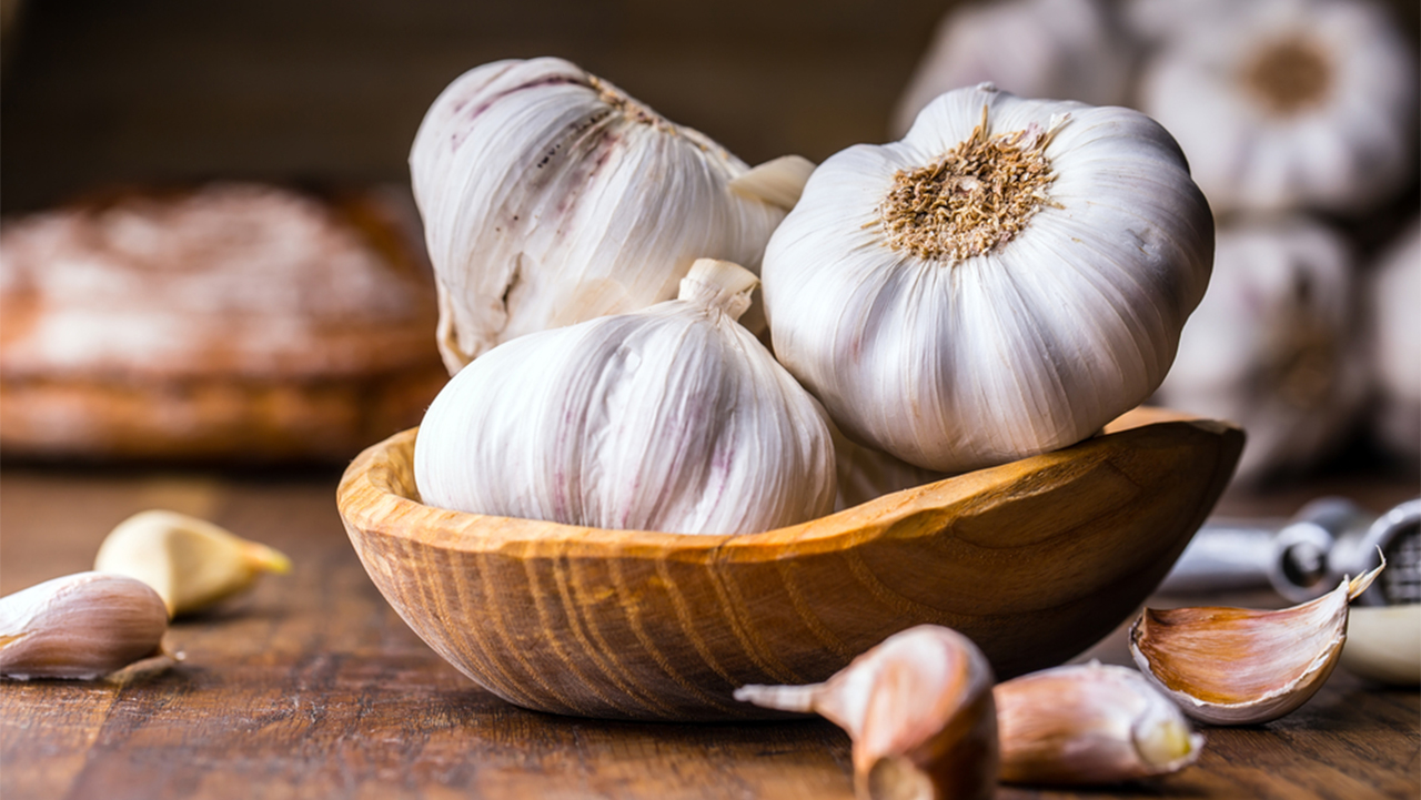 Garlic: Garlic is known to boost immunity, can help in treating a cold or cough and can improve brain functions and memory. (Image: Shutterstock)