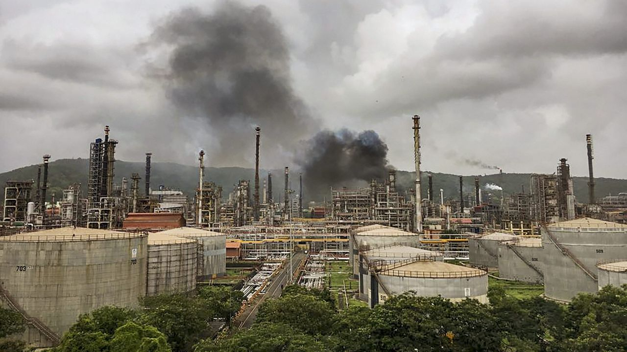 Smoke is seen after a fire broke out at a refinery of Bharat Petroleum after explosions in Chembur area of Mumbai. (Image Source: PTI)