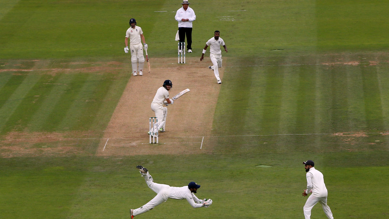 Hardik Pandya finally got the breakthrough for India when he dismissed Jonny Bairstow in the 75th over. Bairstow was looking well set batting on 93 when Pandya lured him into the drive, the ball took an outside edge and Karthik dived brilliantly to his right to take an excellent catch. The wicket also ended the 189-run partnership between the two batsmen. (Image – Reuters)