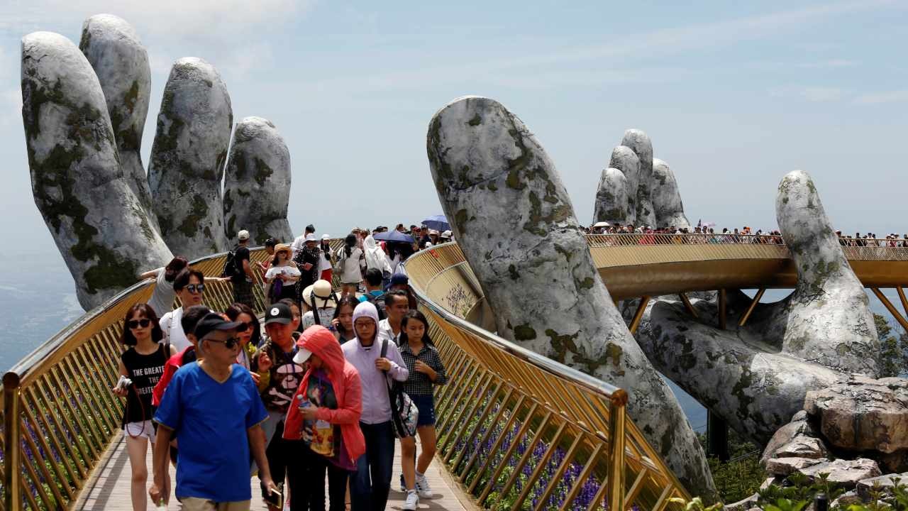 Nestled in the densely forested Ba Na Hills, Vietnam's Golden Bridge has been attracting hordes of visitors since it opened in June this year.