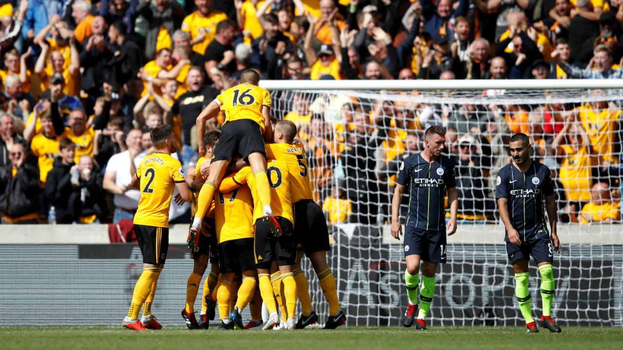 Wolves 1 – 1 Manchester City | Newly promoted side Wolverhampton Wanderers held champions Manchester City to a draw at Molineux. Despite hitting the post twice, City seemed to be headed towards their first defeat of the season when Willy Boly's attempted diving header went in off his hand in the 57th minute. City were rescued by Aymeric Laporte who scored his first goal for the club, connecting with Ilkay Gundogan's free-kick in the 69th minute. (Image – Reuters)