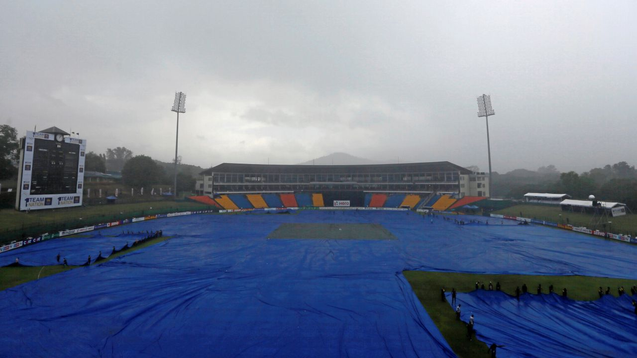 Workers cover the ground as Sri Lanka vs South Africa match at Pallekele, Sri Lanka was delayed due to rain on the fourth One Day International (ODI) cricket match (Image Source: Reuters)