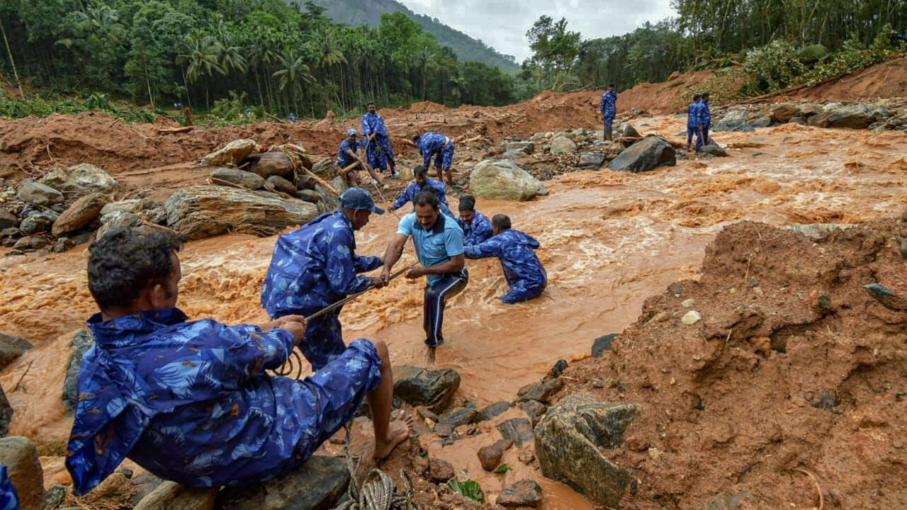 Total of 58 National Disaster Response Force teams have been working in Kerala, making it the largest deployment of the force in a single state since its inception. Pictured: Rescue workers search for bodies of missing persons after a landslide, triggered by heavy rains and floods. (Image: PTI)