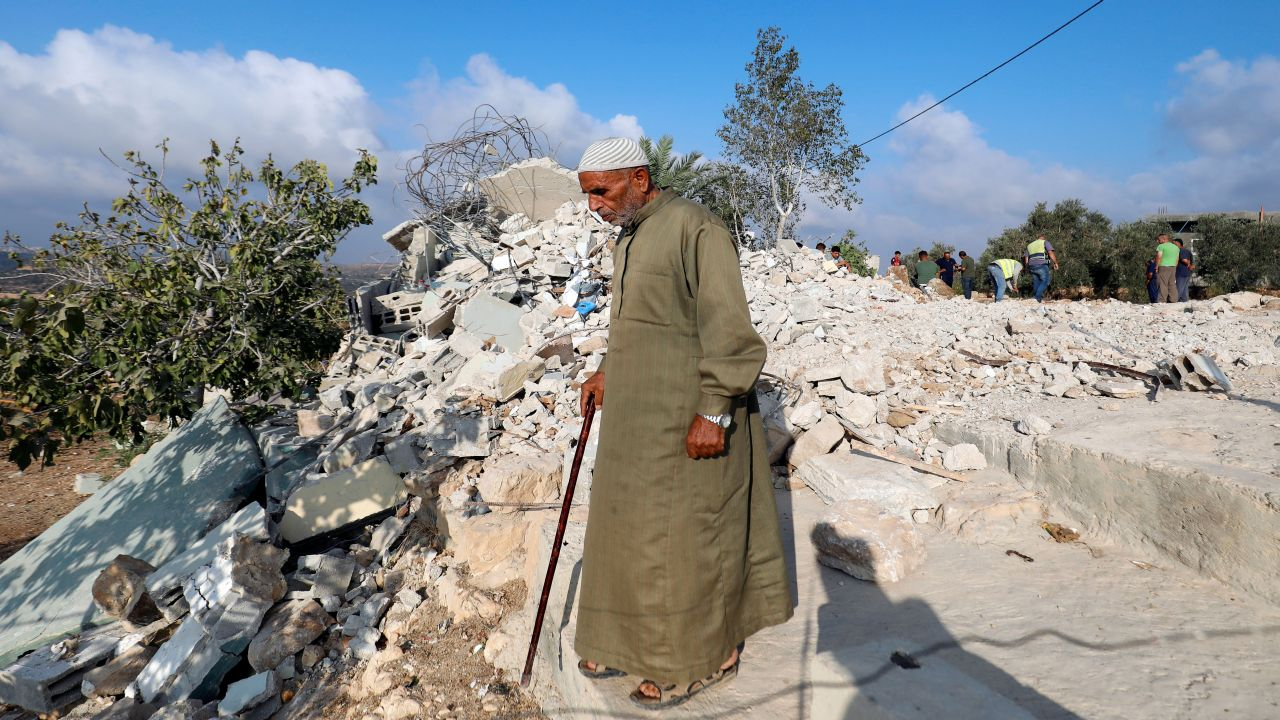 A man walks past the rubble of the family house of Palestinian assailant Mohammed Youssef after it was demolished by Israeli troops in the village of Kobar near Ramallah, in the occupied West Bank. (Image Source: Reuters)