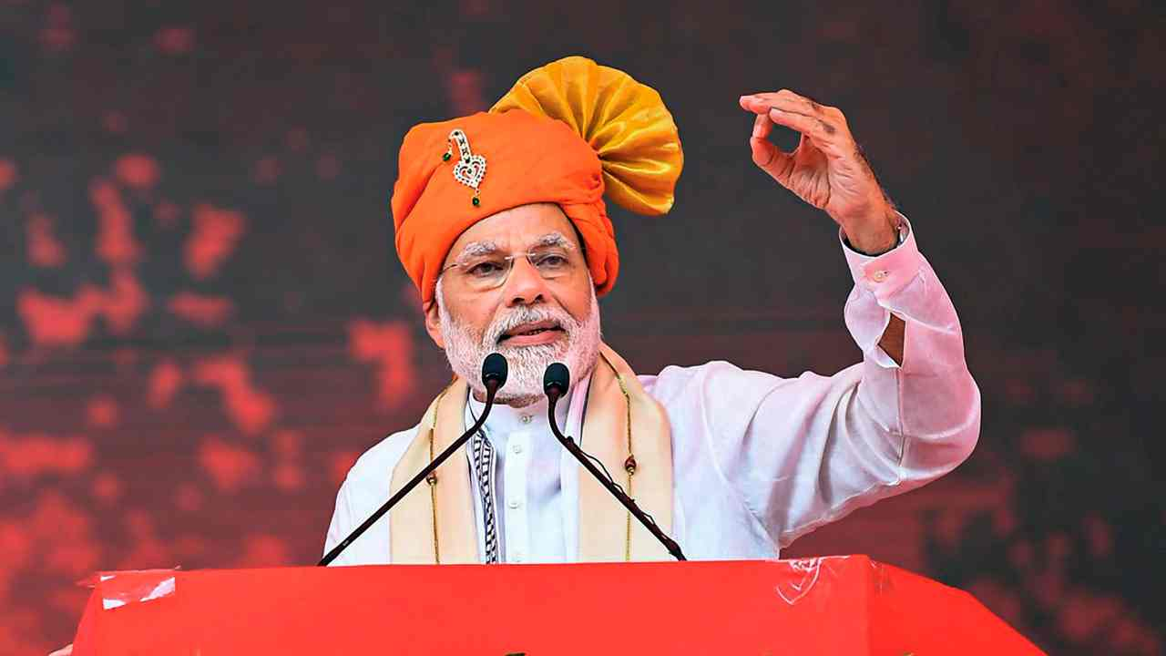 Prime Minister Narendra Modi addresses a public meeting during inauguration of Anand Agricultural University's Incubation Centre cum Centre of Excellence in Food Processing, in Anand, Gujarat. (PTI)