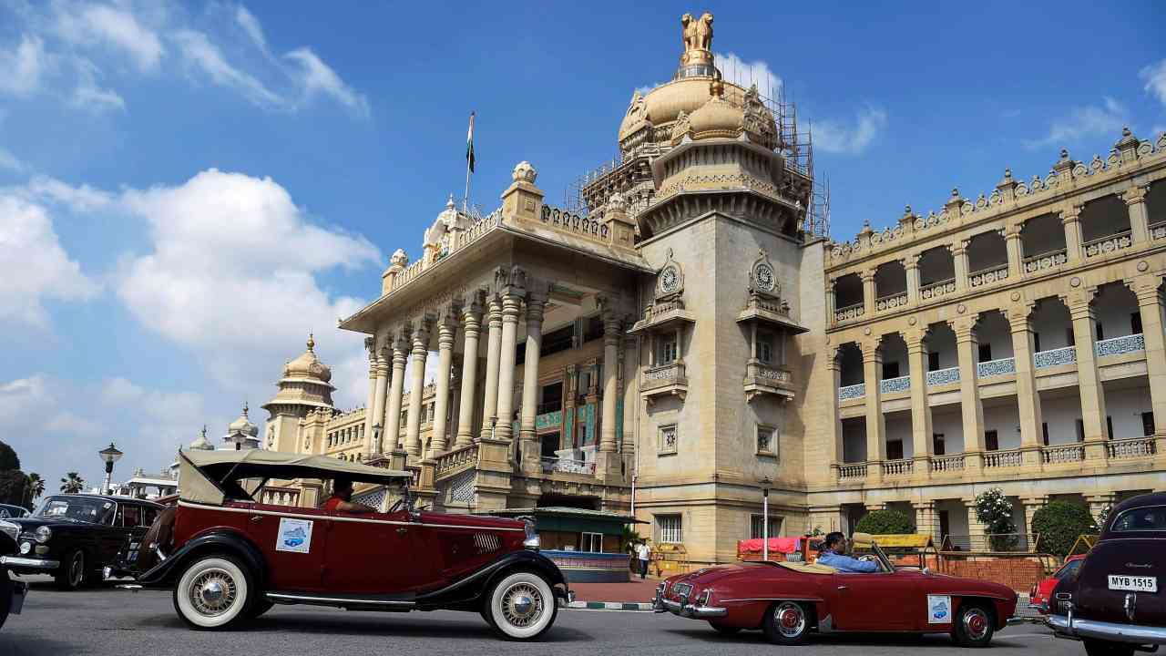 Vintage cars participate in the Heritage, Vintage and Royal Classic Car Drive, in Bengaluru. (PTI)