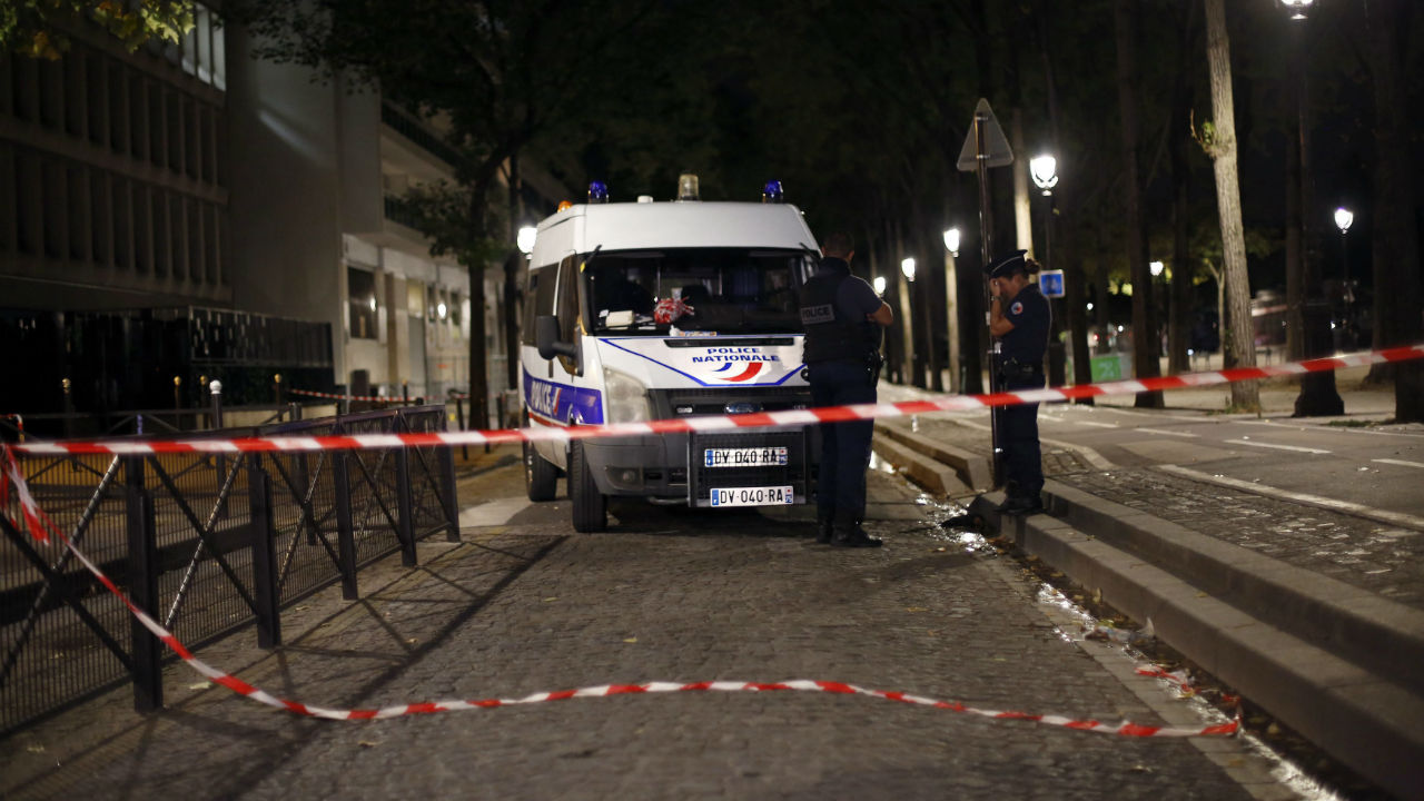 Police officers secure the site of a knife attack in Paris. A several people were injured in a knife attack in central Paris but police said that terrorism was not suspected. (Image: AP/PTI)
