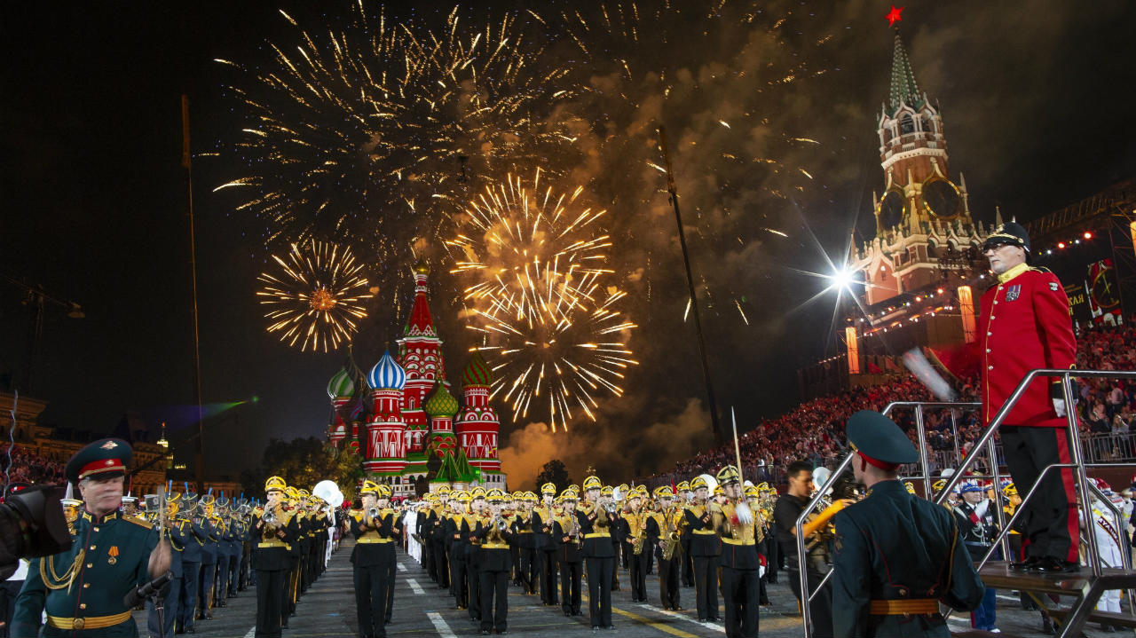 Fireworks explode above the St. Basil Cathedral, background center, as participants perform during the closing of the Spasskaya Tower international military music festival in Red Square in Moscow, Russia. (Image: AP/PTI)