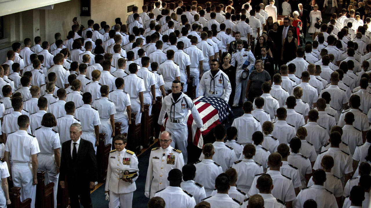 In this image proved by the US Navy, Defense Secretary Jim Mattis (left), leads as the family follows as the casket of Sen. John McCain, R-Ariz., is moved from the Chapel on the grounds of the United States Naval Academy after a service Sunday in Annapolis, Maryland. (Image: PTI)